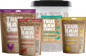 A selection of True Raw Choice natural dehydrated treats including beef lung, chicken feet, duck necks, and Monterey Jack cheese puffs.